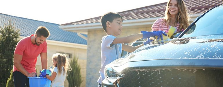family washing a car